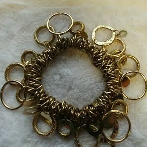 Gold bracelet with lots of circles